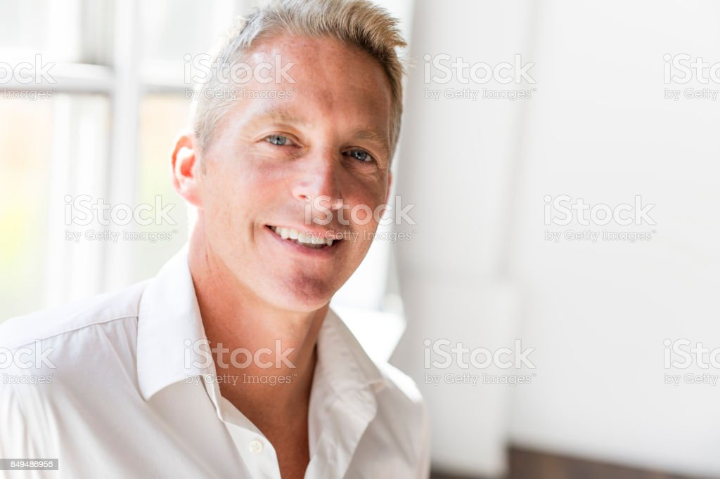 Portrait of attractive 40-year-old man stock photo