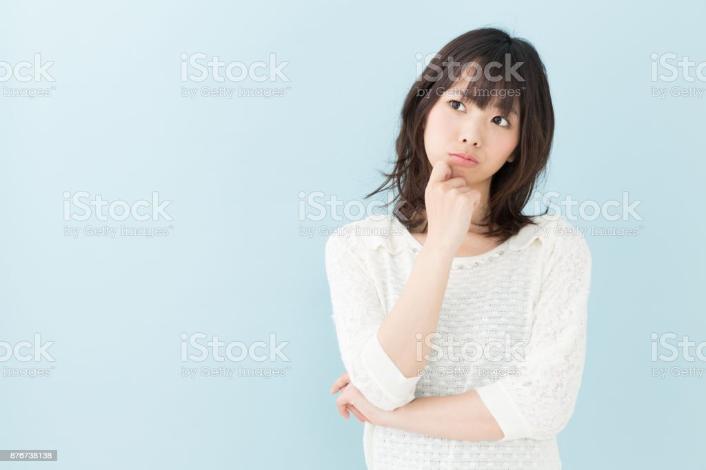 portrait of attractive asian woman isolated on blue background stock photo