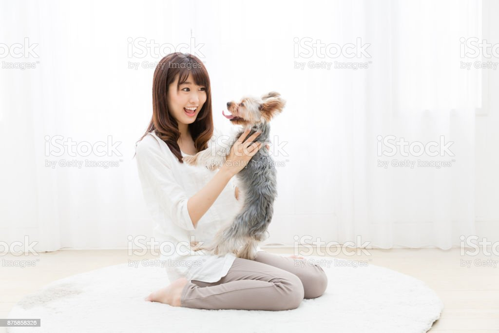 portrait of attractive asian woman with dog