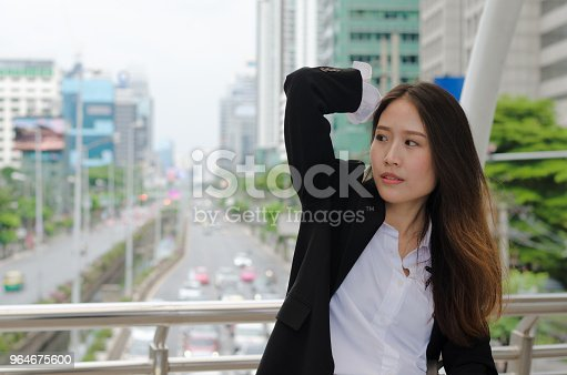 Portrait Of Attractive Business Woman As Smart Look At Outdoor In The Modern City With Building And Traffic Background Stock Photo & More Pictures of Adult