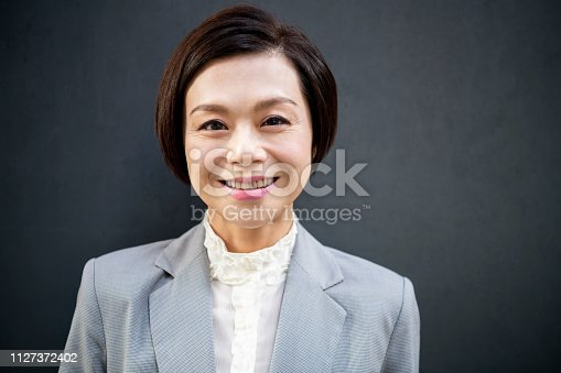 istock Portrait of attractive Chinese businesswoman in her 40s 1127372402