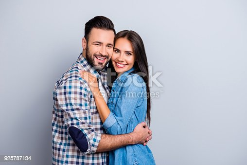 istock Portrait of  attractive, cute, lovely, cheerful couple with beaming smiles, check to check face, looking at camera, over grey background, 14 february 925787134