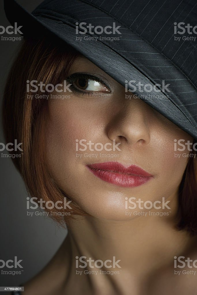 portrait of attractive elegant sexy woman with black hat stock photo