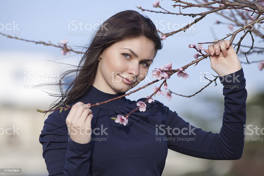 Portrait of attractive long haired brunette on open air royalty-free stock photo