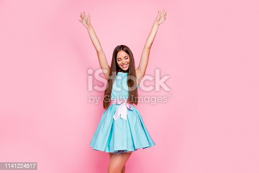 1054970060istockphoto Portrait of attractive lovely lady closing eyes raising arms hands up delighted in modern spring clothing isolated on rose-colored background 1141224517