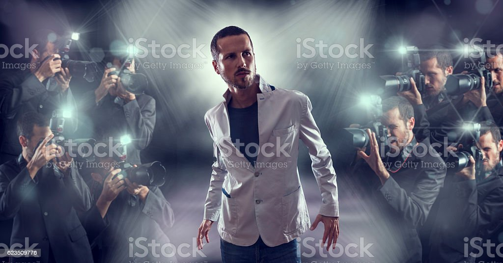 Portrait of attractive male vip celebrity posing stock photo
