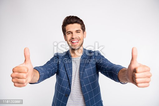 Portrait of attractive man show thumb up advertise ads promo wear modern, style plaid blazer jacket isolated over white background