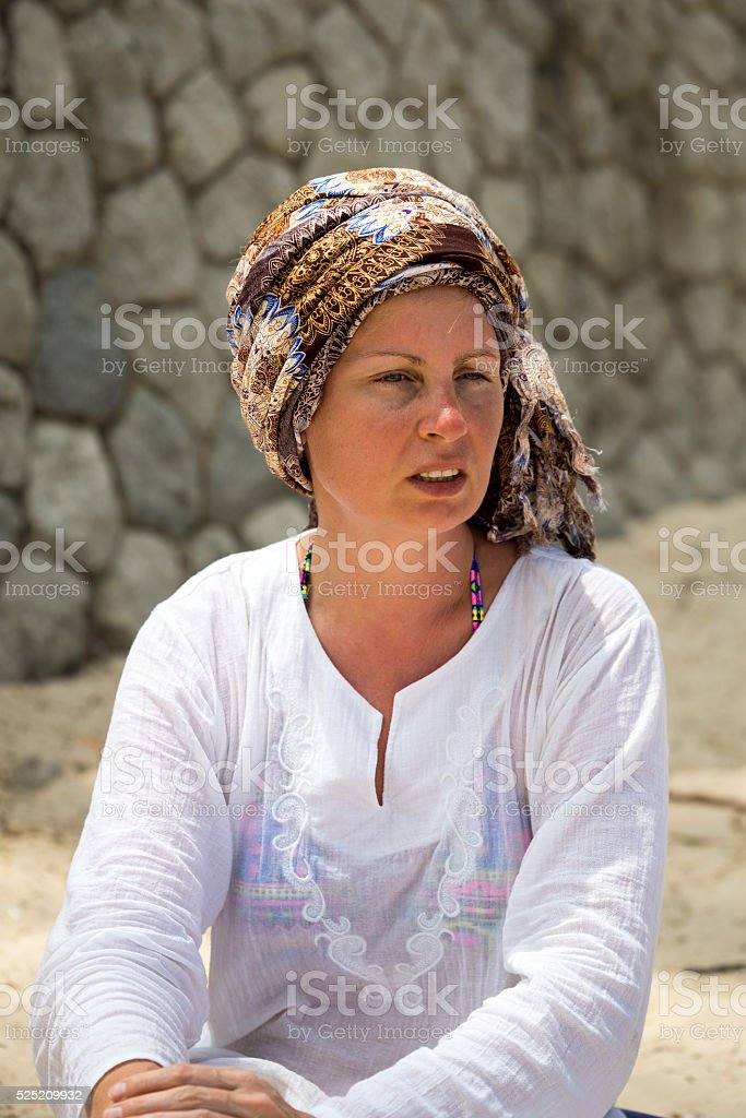 Portrait of attractive mature woman on the beach stock photo
