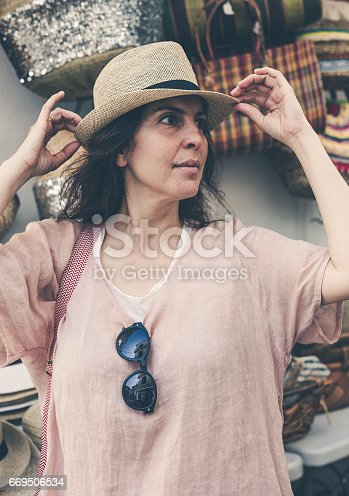 Portrait of attractive middle-aged brunette woman outdoors