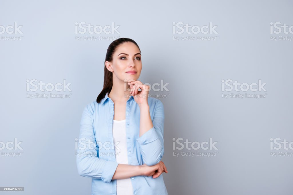 Portrait of attractive minded happy woman dreaming about smth  isolated gray background stock photo