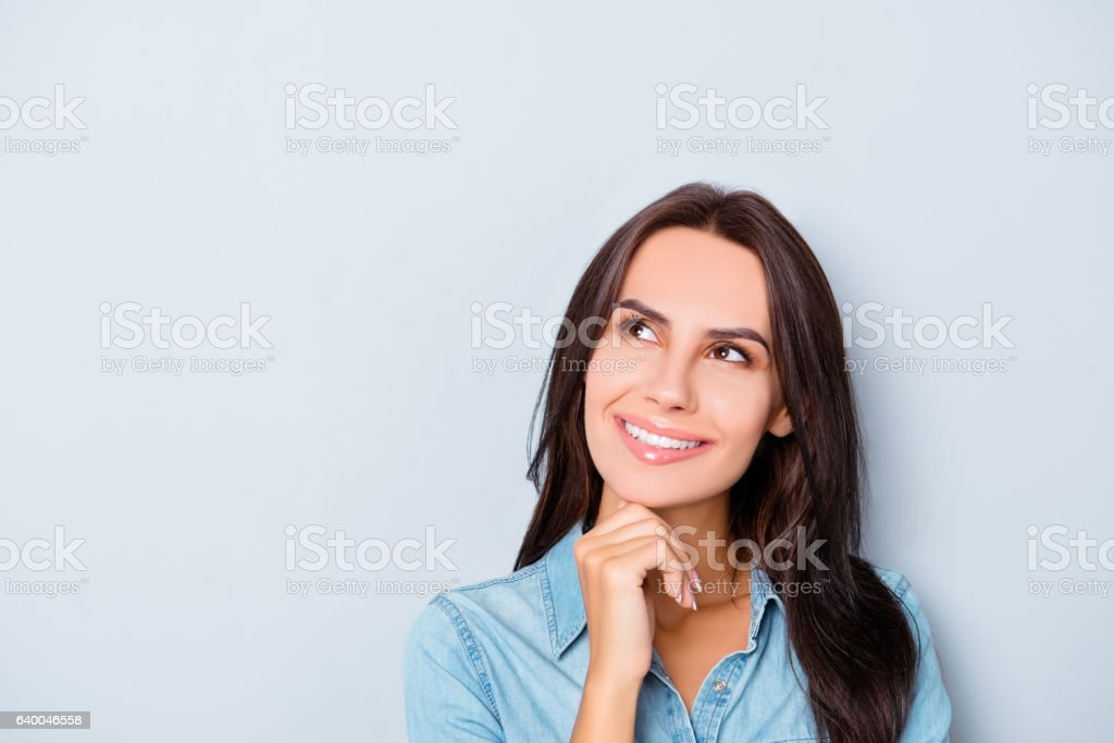 Portrait of attractive minded happy woman dreaming about smth stock photo