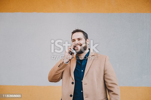 modern young man having a mobile phone conversation