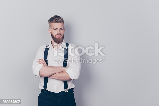 932956896istockphoto Portrait of attractive sexual seductive confident harsh strict strong powerful virile masculine classy posh elegant agent standing with folded arms isolated on gray background 932965802