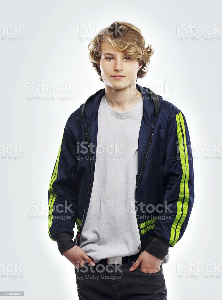 Portrait of attractive teenage boy  smiling at the camera. stock photo