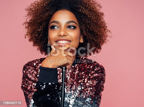 istock Portrait of attractive young afro woman 1283402110