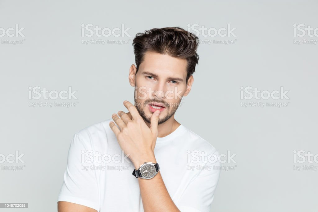 Portrait of attractive young man Portrait of attractive young man posing on grey background 25-29 Years Stock Photo