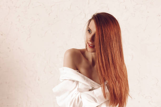 Portrait of attractive young redhead woman with long hair stock photo
