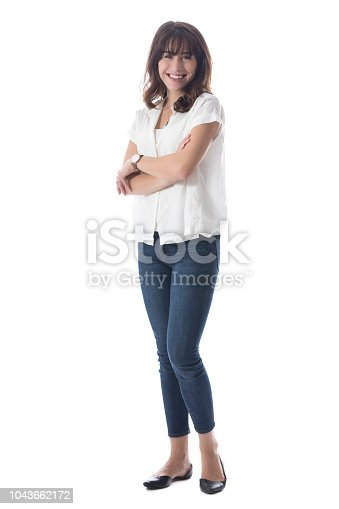 Full body portrait of pretty Caucasian woman standing with arms crossed.