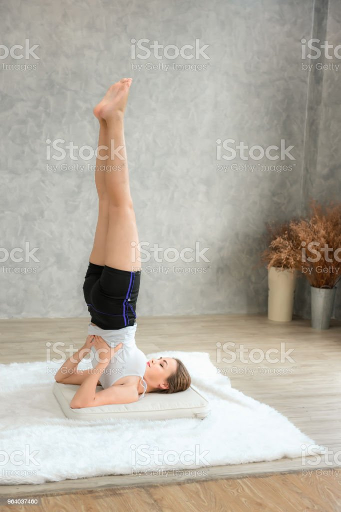 Portrait of attractive young woman practicing yoga indoors, Healthy and yoga concept. - Royalty-free Activity Stock Photo