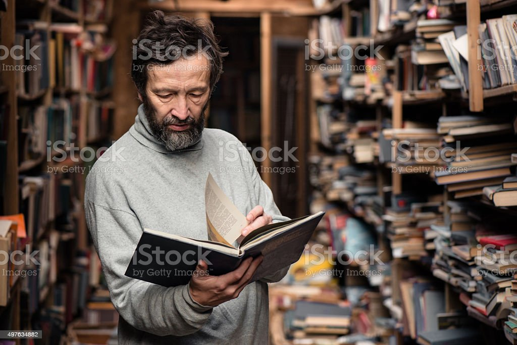 Portrait of authentic senior man on book market stock photo