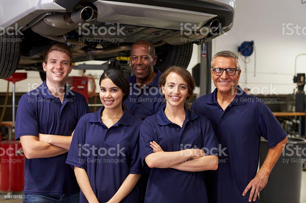 Portrait Of Auto Mechanics Working In Garage stock photo