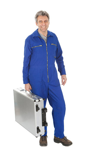 porträt von automechanic stehend mit toolbox - jumpsuit blau stock-fotos und bilder
