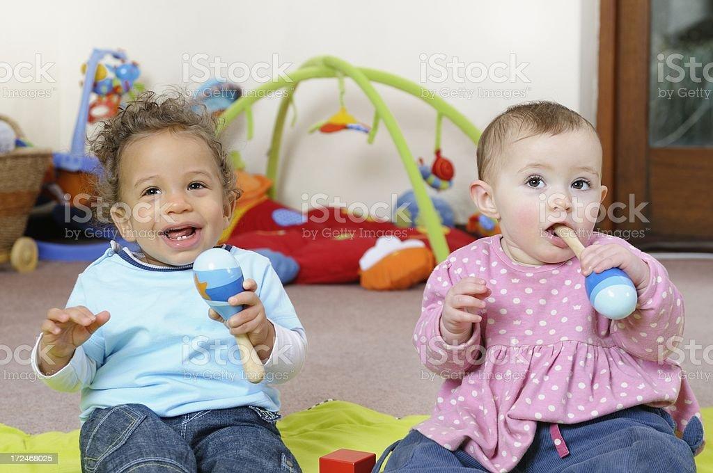 Portrait Of Babies Enjoying Music Through Play stock photo