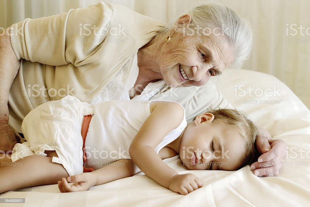 Portrait of baby and great grandmother royalty-free stock photo