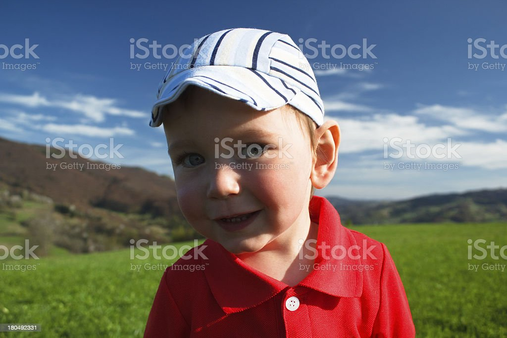 Portrait of Baby boy at mountains background royalty-free stock photo