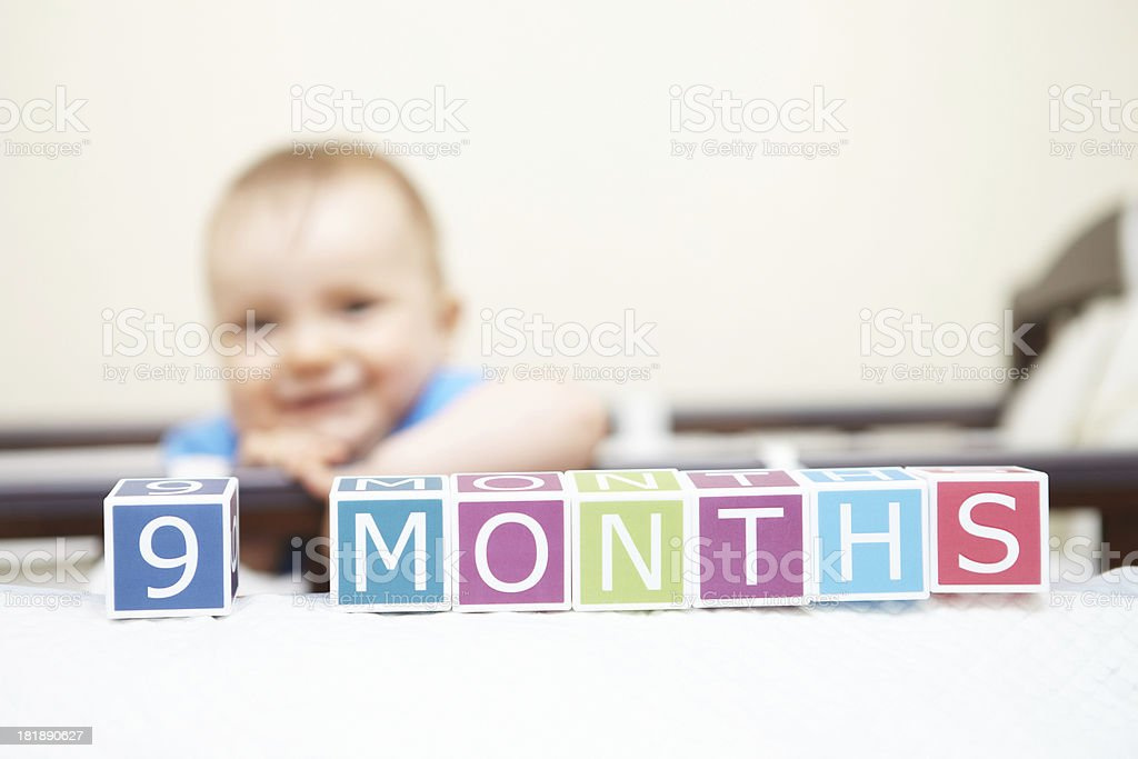Portrait of baby boy in bed. Age concept. royalty-free stock photo