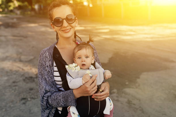 Portrait of baby girl and gorgeous mother. stock photo