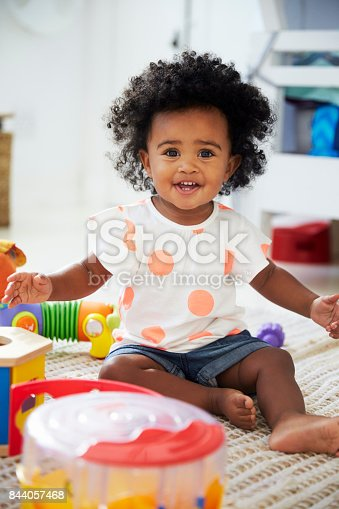 istock Portrait Of Baby Girl Having Fun In Playroom With Toys 844057468