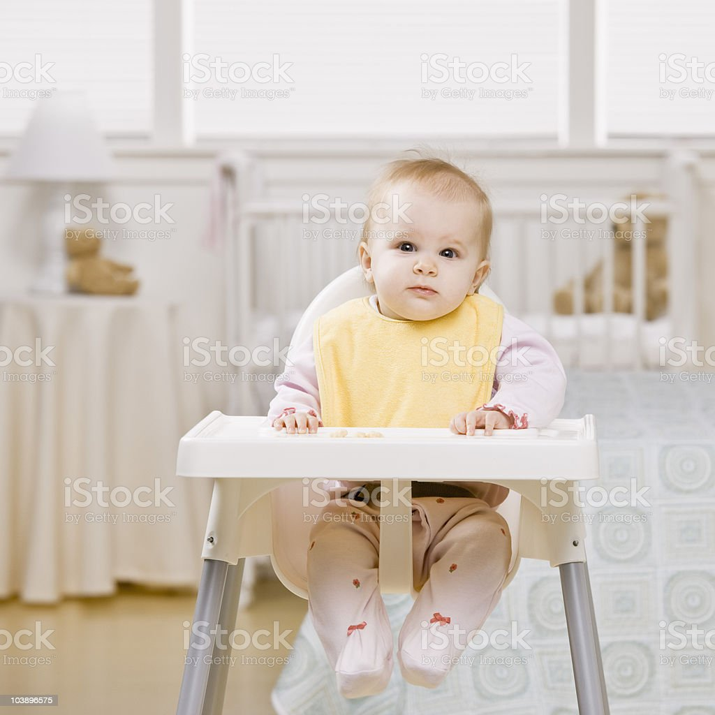 Portrait of baby in highchair stock photo