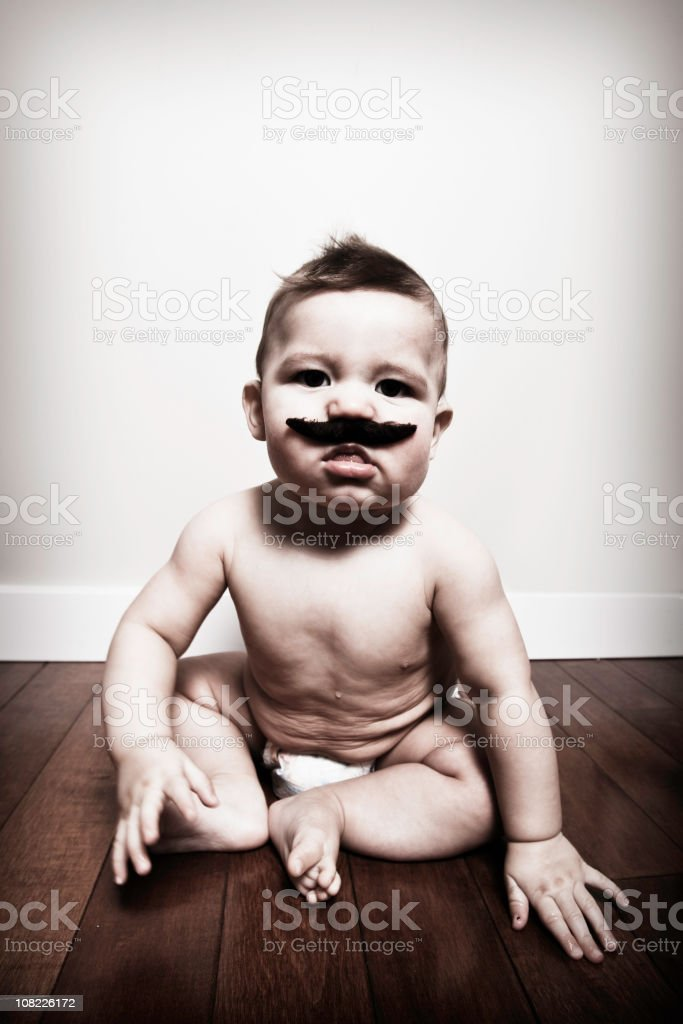 Portrait of Baby Wearing Moustache royalty-free stock photo