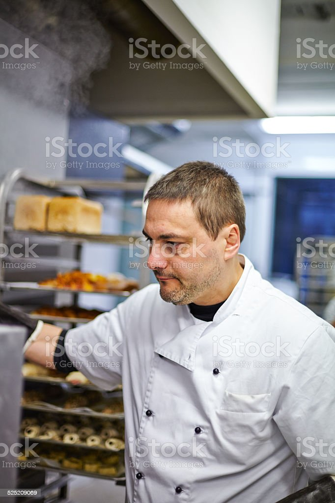 Portrait of baker at work stock photo