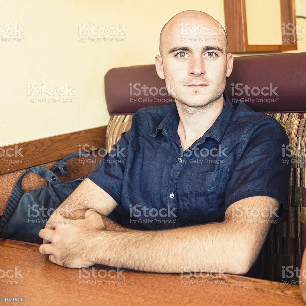 portrait of bald man sitting on a cafè royalty-free stock photo