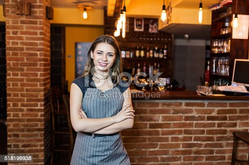 1066358064 istock photo Portrait of barista standing with her arms crossed 518199938