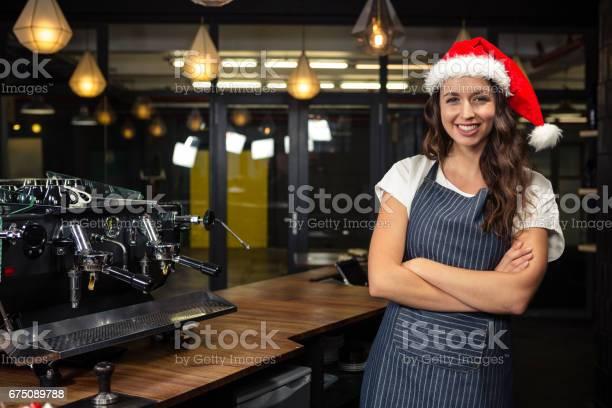 Portrait of barista wearing santa hat picture id675089788?b=1&k=6&m=675089788&s=612x612&h=d2d4xciivlbzrcks9wh4e8udux8ua9fousiti6uxyf8=