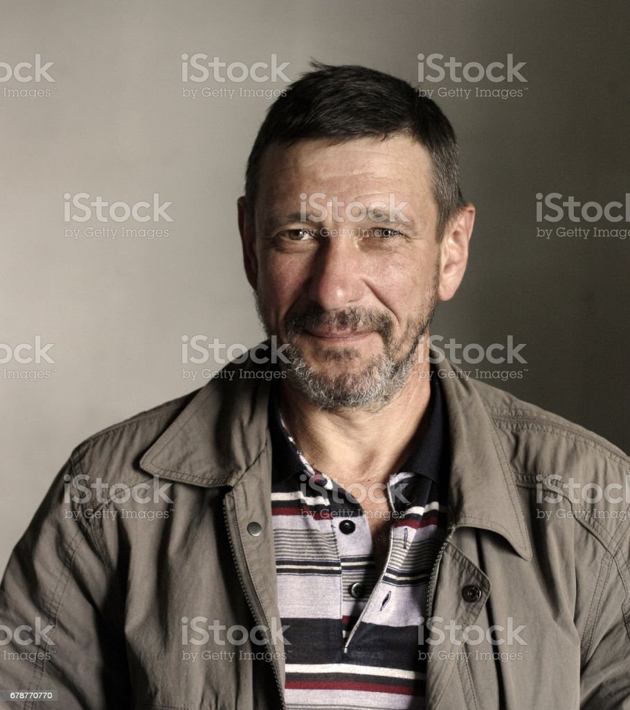 Portrait of bearded 50-year-old man with mocking face grunge style stok fotoğrafı