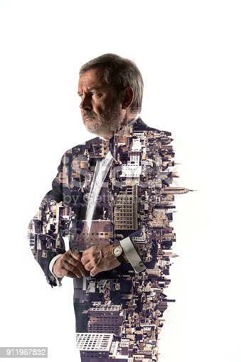 istock Portrait of bearded businessman. Double exposure city on the background 911967832