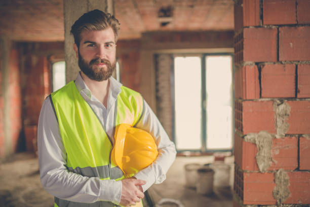 Portrait of bearded engineer wearing safety clothes stock photo