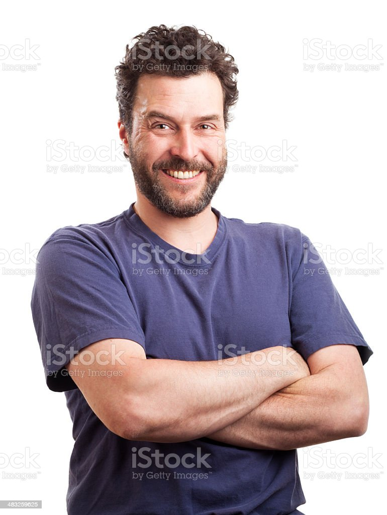 Portrait of bearded European man with arms crossed, smiling stock photo