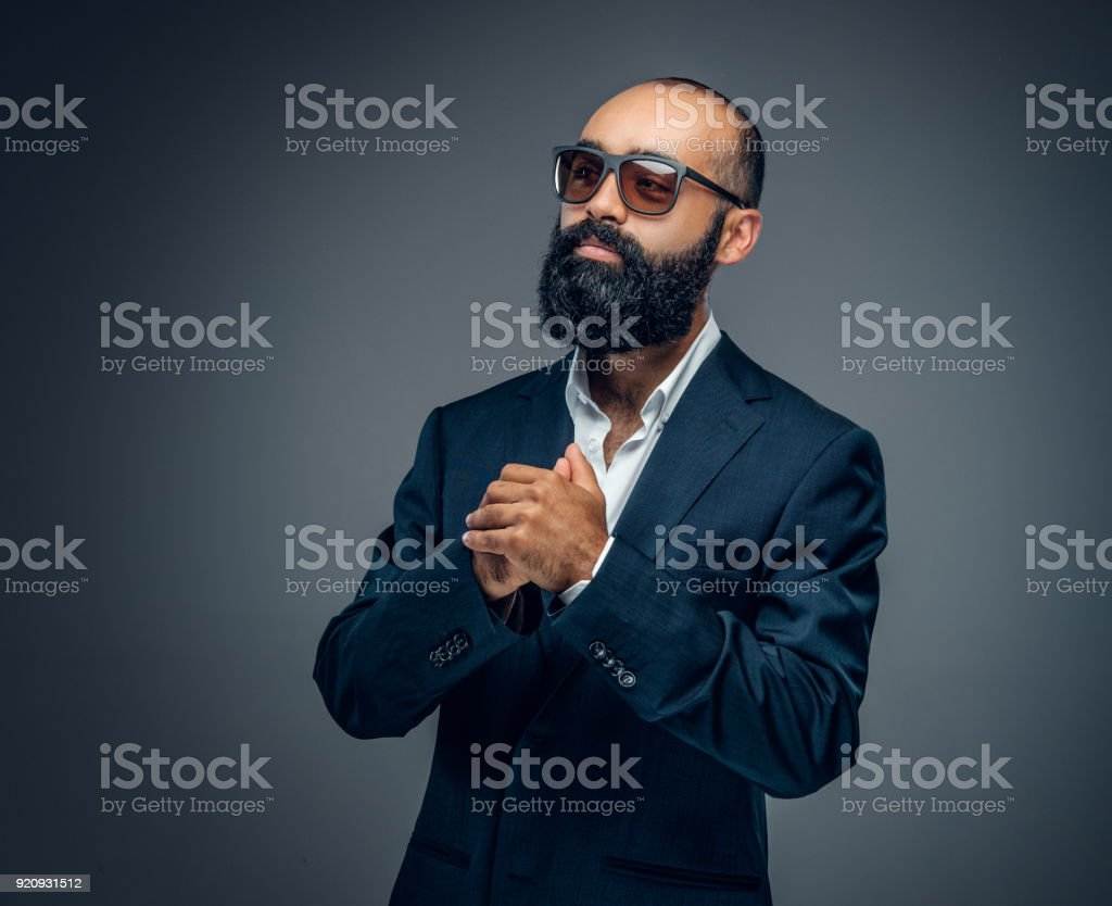 Portrait of bearded male in a business suit. stock photo