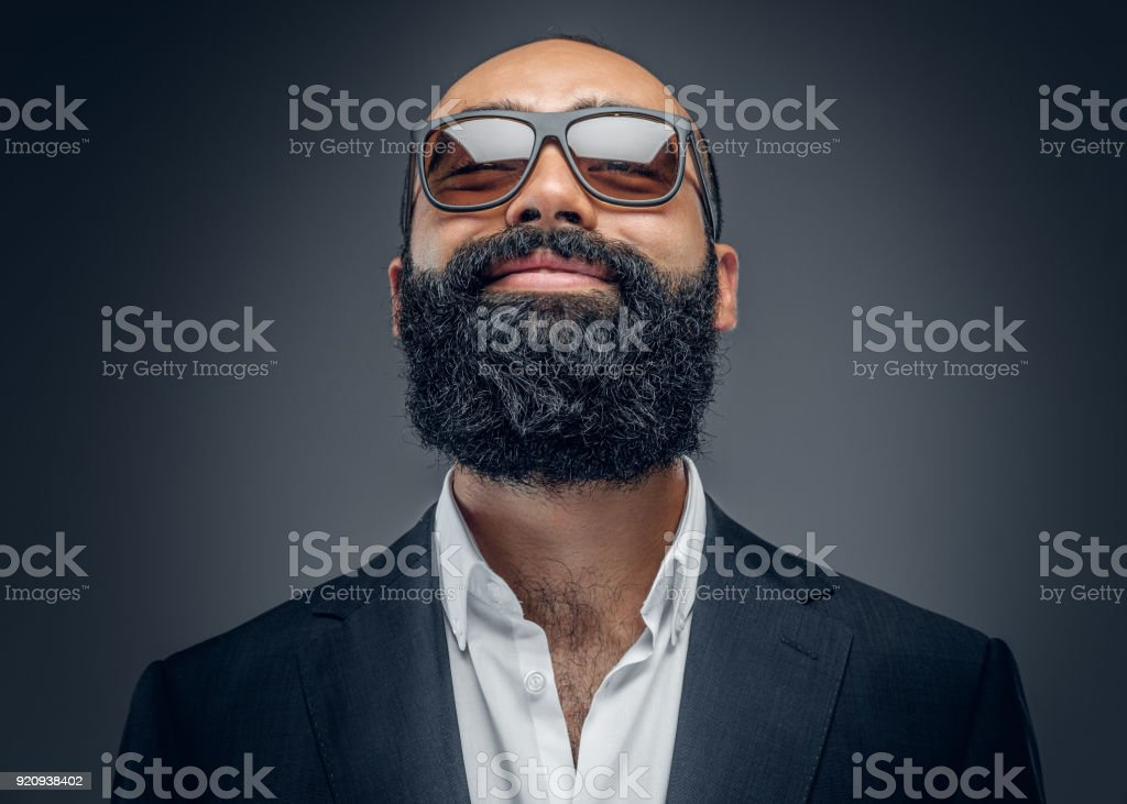 Portrait of bearded male in a suit and sunglasses. stock photo