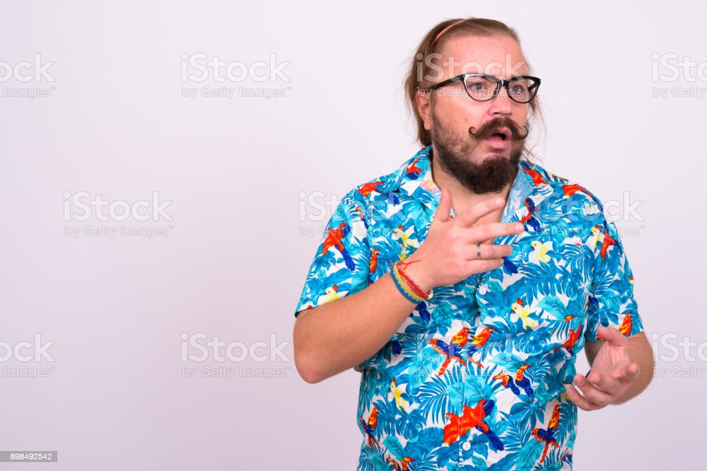 9725bb566 Portrait of bearded man with mustache and long hair against white  background wearing Hawaiian shirt - Stock image .