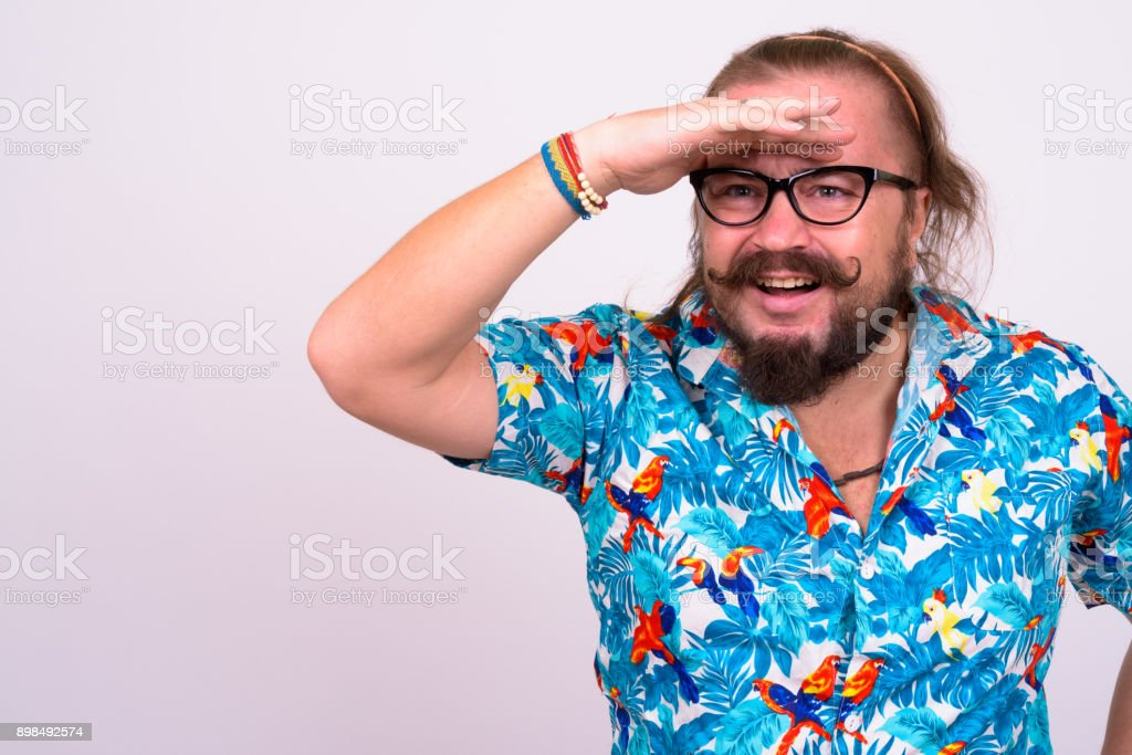 74b1b4036 Portrait of bearded man with mustache and long hair against white  background wearing Hawaiian shirt foto