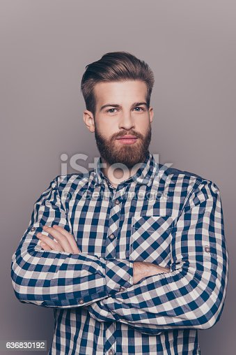 636829300 istock photo portrait of bearded thinking stylish young man crossing hands 636830192