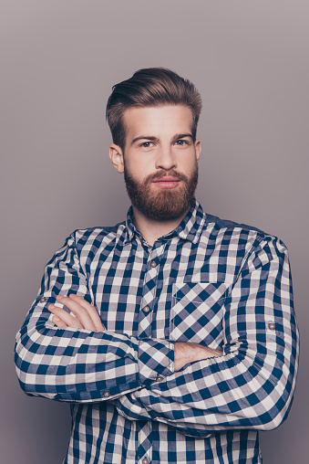 636829368 istock photo portrait of bearded thinking stylish young man crossing hands 636830192
