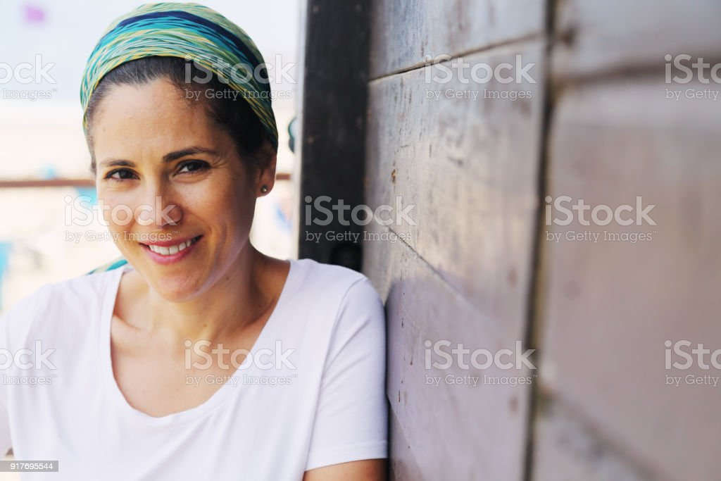 Portrait of beautiful 40 years old woman outdoors stock photo