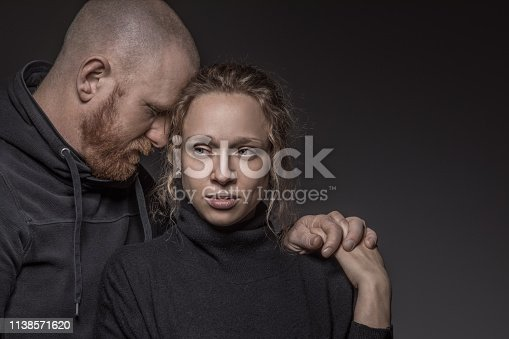 Portrait of beautiful blonde woman and handsome bearded redhead man in sad emotional moment